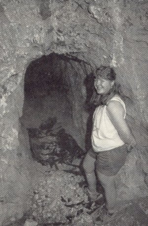 : Lu Anne Warren, author's wife, standing in front of the entrance to the Monte Cristo Mine