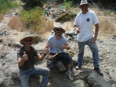 "We started calling these guys the ""Alpha Team"" after they moved some boulders and uncovered the ancient streambed material that is under their feet."